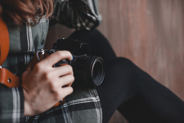 woman photographer holding professional camera