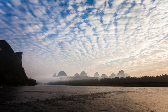 Early morning altocumulus clouds and river scene