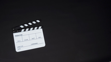 White Clapperboard or clap board or movie slate on black background. It's use in video production , film, cinema industry.