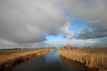 Light rainbow above the source of the river Rotte at the Wilde Veenen polder in Moerkapelle the Netherlands