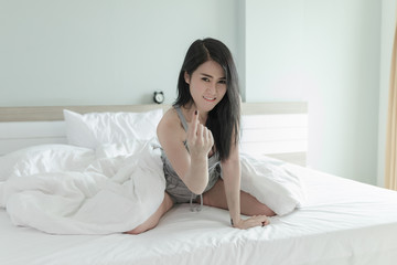 thai girl dressed sexy in the bedroom