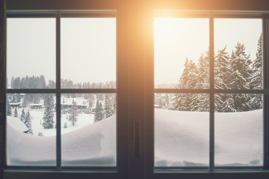 View of the winter landscape through the window. Vintage filter, selective focus