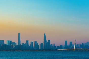 Fototapete - Skyline of Shekou district, Shenzhen City, China under sunset. Viewed from Hong Kong