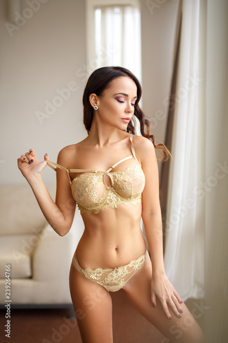 b0c9febc9 Perfect girl in a sexy gold lingerie