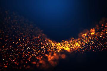 Golden fire particles trail wave blur on dark blue gradient background