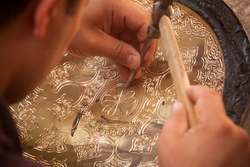 Artisans carving plates
