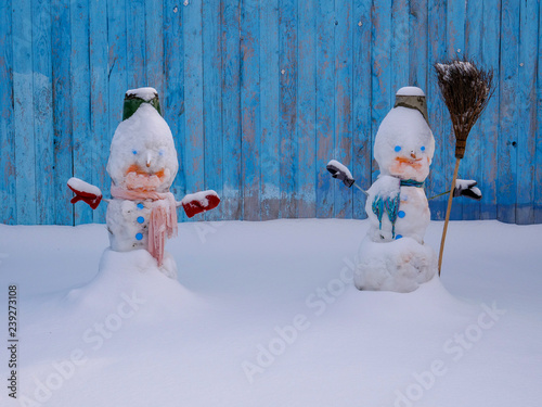 White Snowman Dressed In Scarf Tin Bucket With Blue Eyes And Carrot