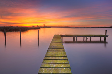 Old jetty on a lake at sunset