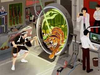 装置を使って虎を捕まえようとする男性