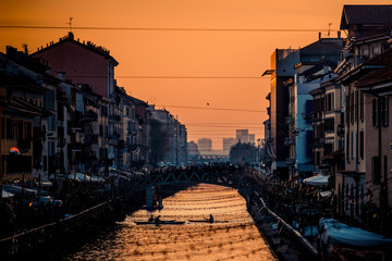 Fotomurales - sporting people have fun with canoe at Navigli Milano Italy - winter xmas time