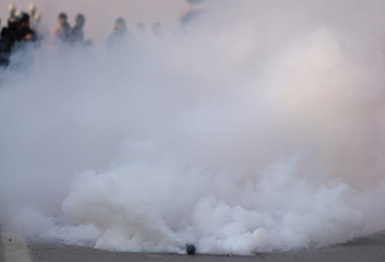 A tear gas shell fired by Indian police explodes during a protest march in Srinagar