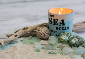 Beach still life with candle, shells and driftwood Wall mural