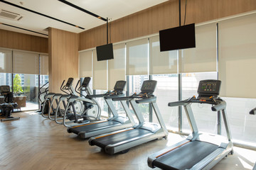Modern fitness center with gym equipment decoration. interior design background