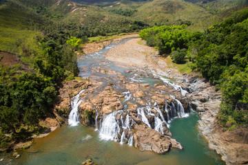 Impressive waterfalls on Koua river aerial view, between Poro and Kouaoua, North Province, New Caledonia, Melanesia, Oceania, overseas territory of France, South Pacific Ocean.