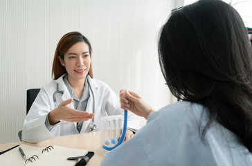 Female doctor explaining to patient about to use Incentive Spirometer