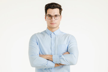 Young hipster office man arms crossed.