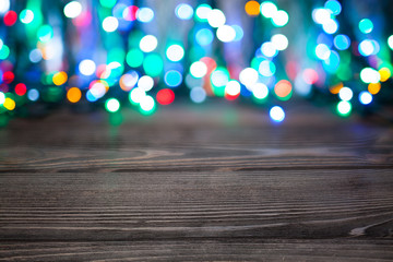 Abstract background - multicolored lights on wooden table