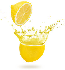 yellow juice exploding out of a lemon isolated on white background