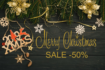 Board with post Merry Christmas sale.