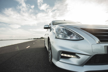 Car Blonde traveling in nature on an asphalt road  Fotomurales