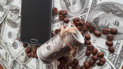 American dollars background, coffee bean with mobile cell