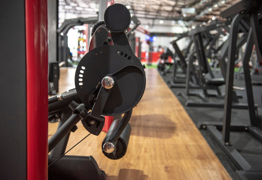diverse equipment and machines at the gym room - Image