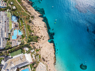 Cyprus beautiful coastline, Mediterranean sea of turquoise color. Houses on the Mediterranean coast. Tourist town with a Long beach. Summer vacation at sea. top view, aerial view, Cyprus, Ayia NAPA.