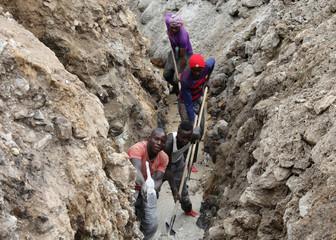 Miners work in a coltan mine in Rukunda, Masisi territory, North Kivu Province of Democratic Republic of Congo