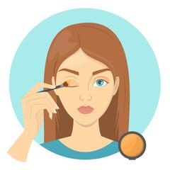 Beautiful woman applying the yeshadow on eyelid