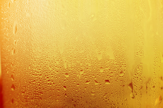 Water vapor in cold Drops of water on a glass of beer , droplets Misted abstract pattern texture background.