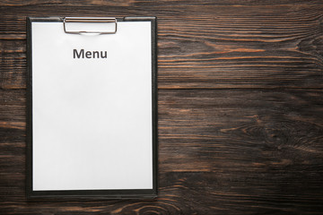 Blank menu on wooden table