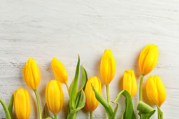 Beautiful tulips for Mother's Day on white wooden background