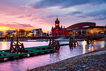 Waterfront at night in Cardiff, UK. Sunset colorful sky with Wales Millennium Center