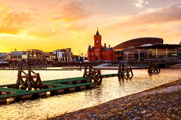 Waterfront at night in Cardiff, UK. Sunset colorful sky at Cardiff Bay.