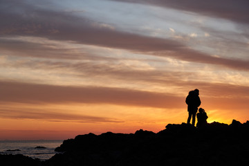 The Silhouette Of Lovers Watching The Sunset