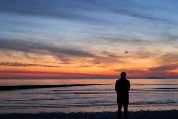 The Silhouette Of Man Watching The After Sunset