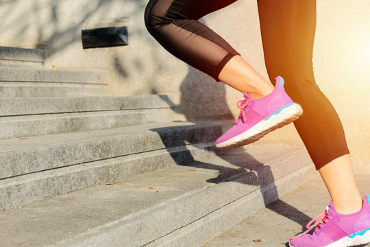 Fitness sport concept, young woman running up the stairs.