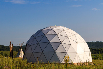 white geodesic dome on a sunny summer day in nature