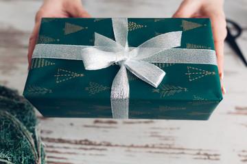 Woman Holding Christmas Presents