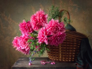 Still life with bouquet of pink dahlia flowers
