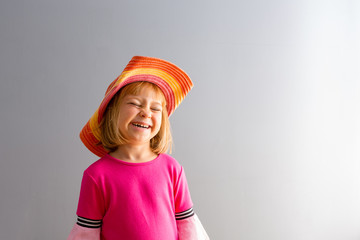 Young girl laughing with eyes closed