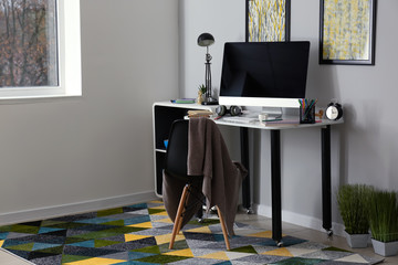 Stylish workplace of designer with modern computer