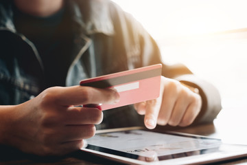 Online payment,Man's hands credit card and using digital tablet computer for online shopping. Cyber Monday Concept