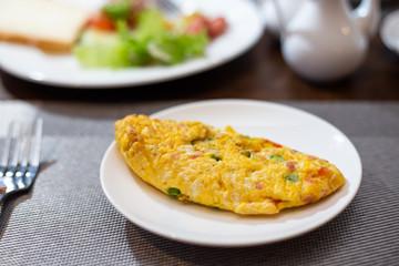 breakfast omelette, scrambled eggs on Table