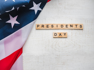 Presidents' Day. Beautiful greeting card. White, isolated background, close-up, top view, wooden surface. Congratulations for loved ones, relatives, friends and colleagues