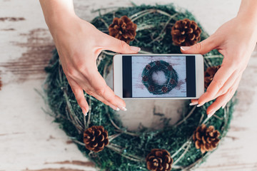 Woman Take Picture Of Christmas Wreath