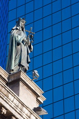 Statue on the Cathedral Metropolitana and modern office building in Plaza de Armas, Santiago, Chile, South America