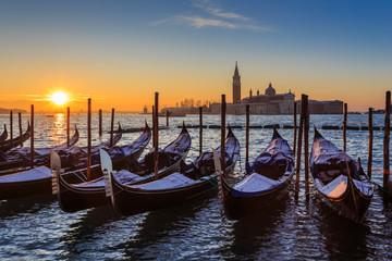 Venetian winter sunrise after snow; gondolas, San Giorgio Maggiore and Lido; Venice, UNESCO World Heritage Site, Veneto, Italy