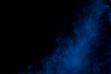 thick and mysterious blue cigarette vapor on a dark background bewitching abstraction