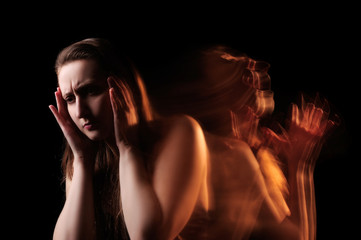 The concept of migraine at the black background